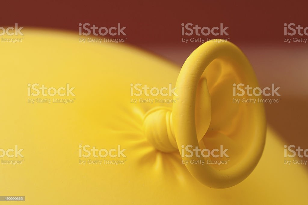 Knotted yellow balloon stock photo