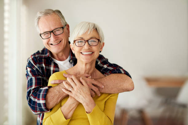 I know he's always got my back Cropped portrait of a senior man affectionately embracing his wife at home husband stock pictures, royalty-free photos & images