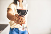 Cropped shot of an unrecognizable woman holding a glass of wine