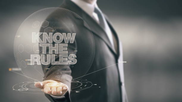 Know The Rules Businessman Holding in Hand New technologies stock photo