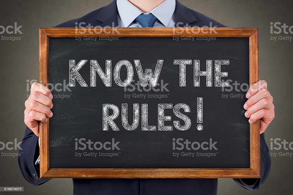 Know The Rules on Blackboard stock photo