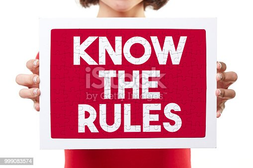 woman holding know the rules puzzle