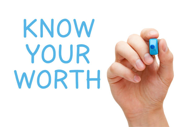 Know Your Worth Hand writing Know Your Worth with blue marker on transparent wipe board.