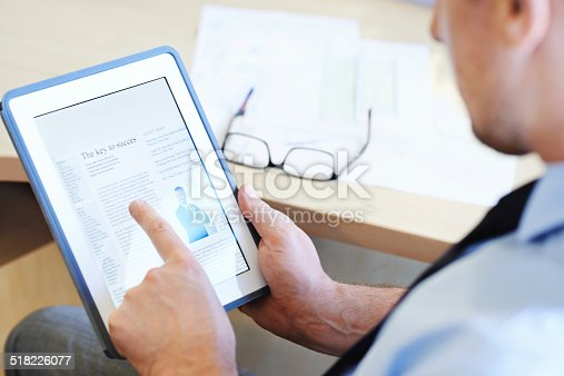 Cropped shot of a businessman working on a digital tablet