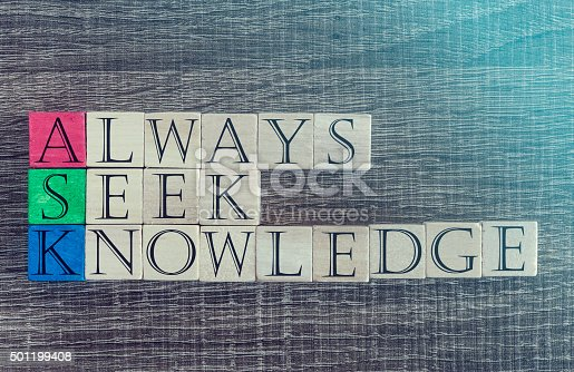 Knowledge concept with quote written on wooden blocks. Cross processed image