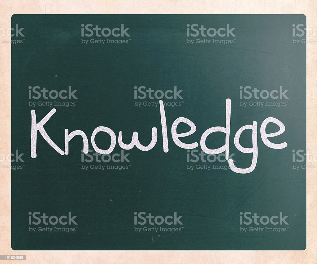 'Knowledge' handwritten with white chalk on a blackboard royalty-free stock photo