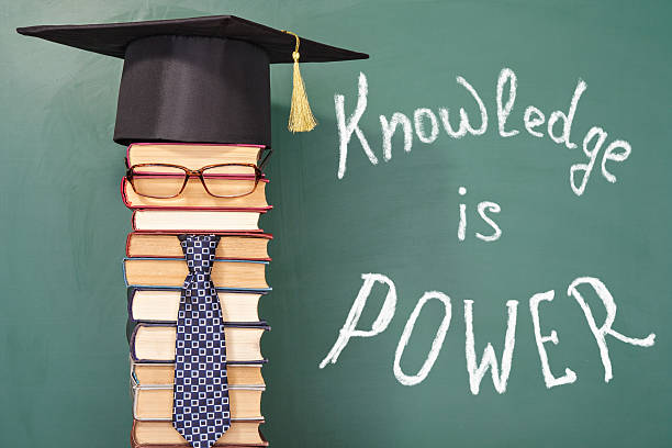 knowledge is power education funny concept - humor bücher stock-fotos und bilder