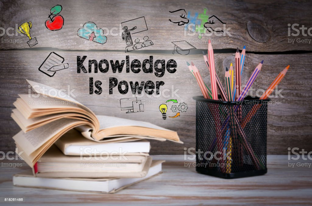 Knowledge is power. Stack of books and pencils on the wooden table. stock photo