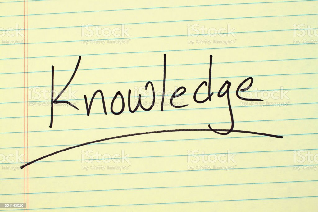 Knowledge On A Yellow Legal Pad stock photo