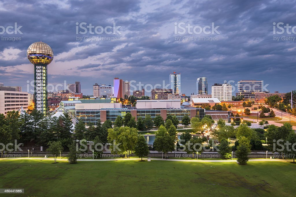 Knoxville Tennessee at dusk under cloudy sky stock photo