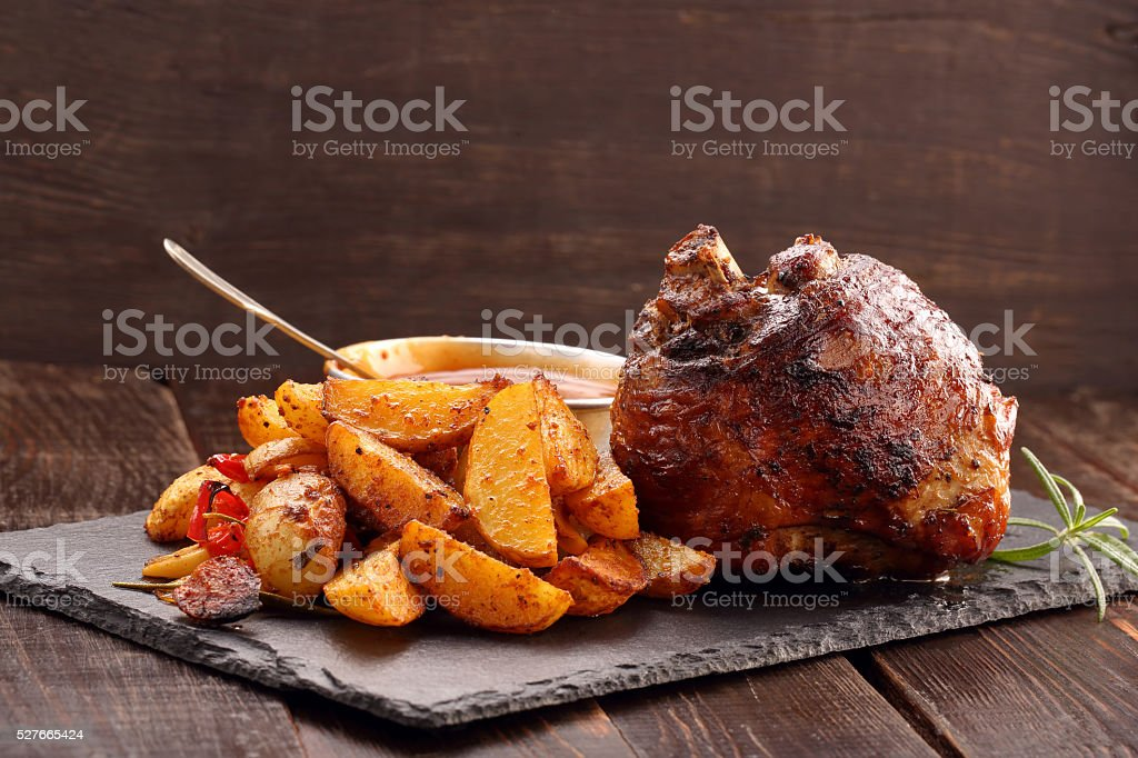 Knuckle of turkey with baked potato and dip stock photo