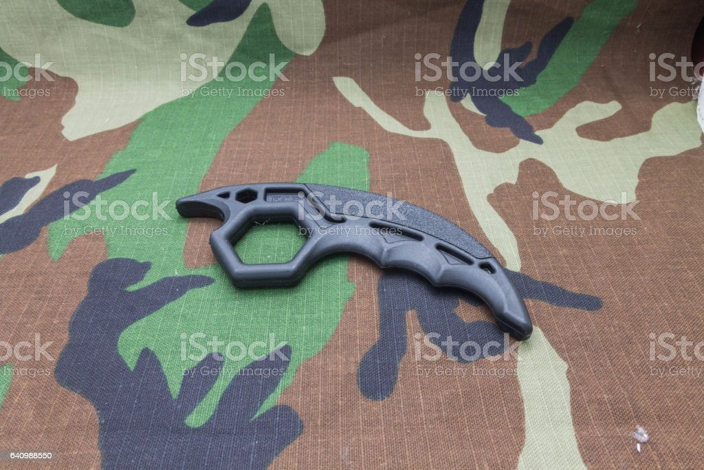 Knuckles on camouflage background. stock photo