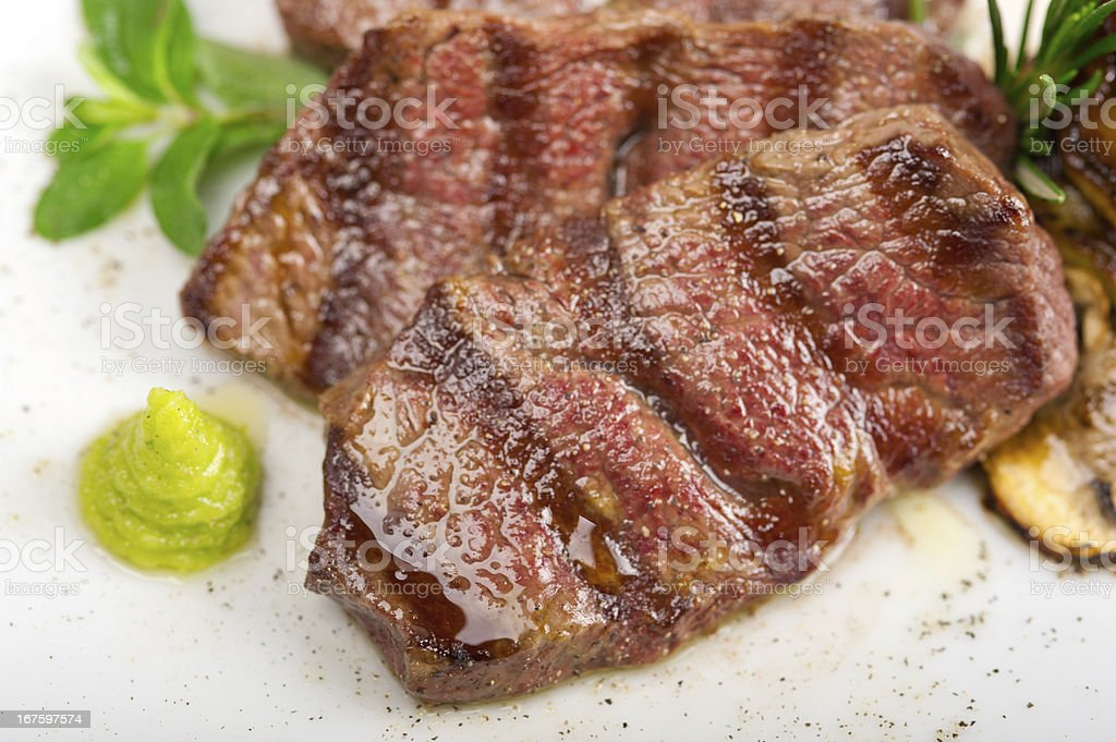 Kobe Miyazaky beef grilled with a side of fresh vegetables. stock photo