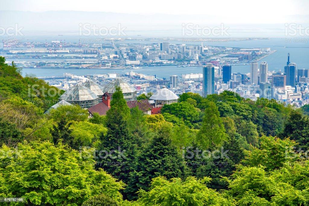 Kobe Port Island and Kobe Airport in Osaka Bay seen from Nunobiki Herb Garden on Mount Rokko in Kobe, Japan stock photo