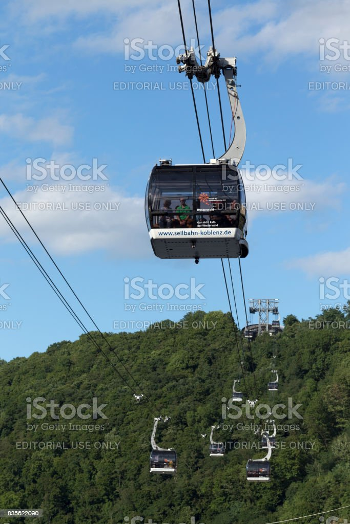 Koblenz cable cars on foliage and sky background stock photo