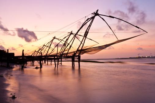 Chinese fishing nets at sunset.