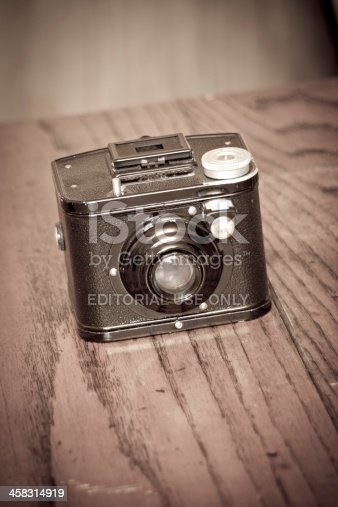 Hvidovre, Denmark - April 1, 2013: Kodak box 920. Vintage Kodak used for photography placed on a wooden table.