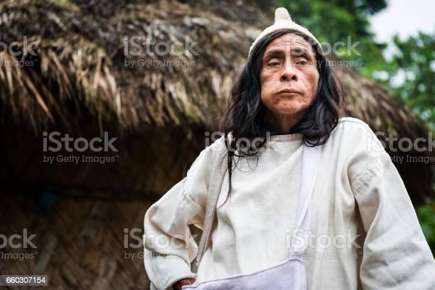 Kogi mamas chewing coca leaves in front of a hut in the forest in the picture id660307154?b=1&k=6&m=660307154&s=612x612&h=redoeplvzsmsqigd 6wlxnmqon sriz0suld5012c o=