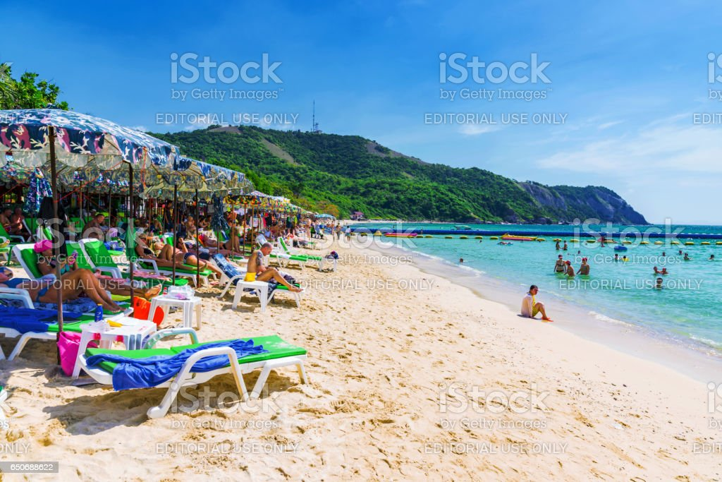 Koh Lan island beach with toursits sunbathing royalty-free stock photo
