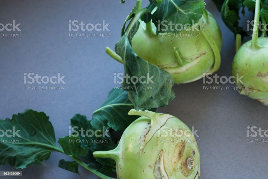 Kohlrabies (cabbage turnips) raw on neutral background. stock photo