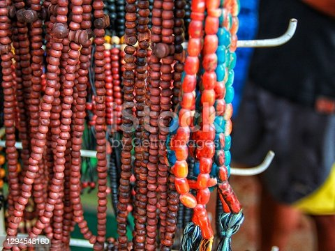 The wearer of the wooden kokka necklace bracelet is commonly used by Indonesian people as a symbol and icon close to religion