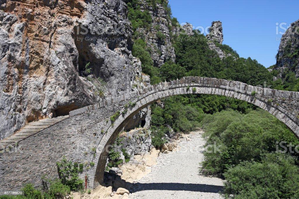 kokkori stone arched bridge Zagoria Greece stock photo