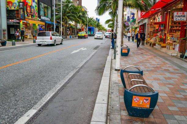 Kokusai Dori street at Naha Okinawa Japan OKINAWA, JAPAN - MARCH 1, 2017 : Kokusai Dori street and market, famous shopping street in Naha Okinawa Japan kokusai dori okinawa stock pictures, royalty-free photos & images