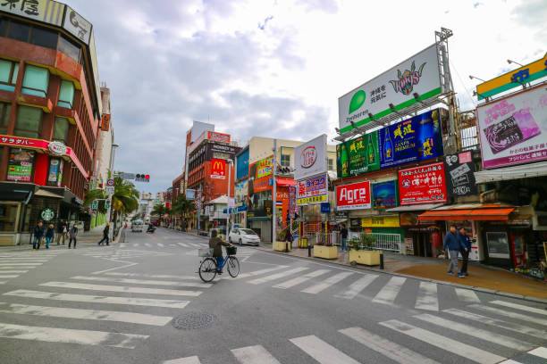 Kokusai Dori street, Okinawa Japan OKINAWA, JAPAN - MARCH 1, 2017 : Kokusai Dori street, shopping center in Naha Okinawa Japan kokusai dori okinawa stock pictures, royalty-free photos & images