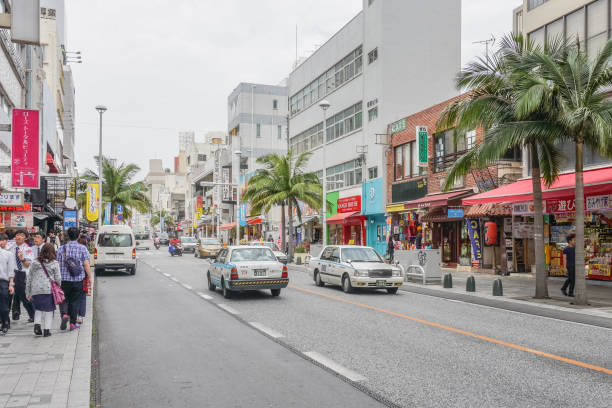 Kokusai dori, the main street in Naha City, Okinawa, OKINAWA, JAPAN - April 19 , 2017:  Kokusai dori, the main street in Naha City, Okinawa, kokusai dori okinawa stock pictures, royalty-free photos & images