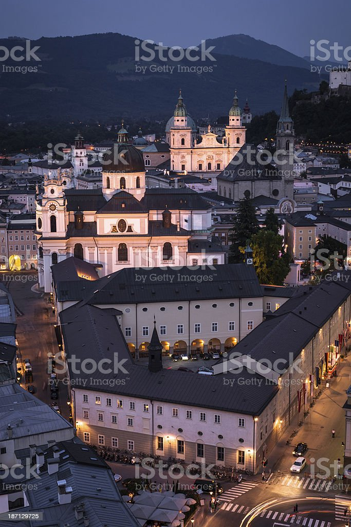 Kollegienkirche and Salzburg Cathedral at night in Austria stock photo
