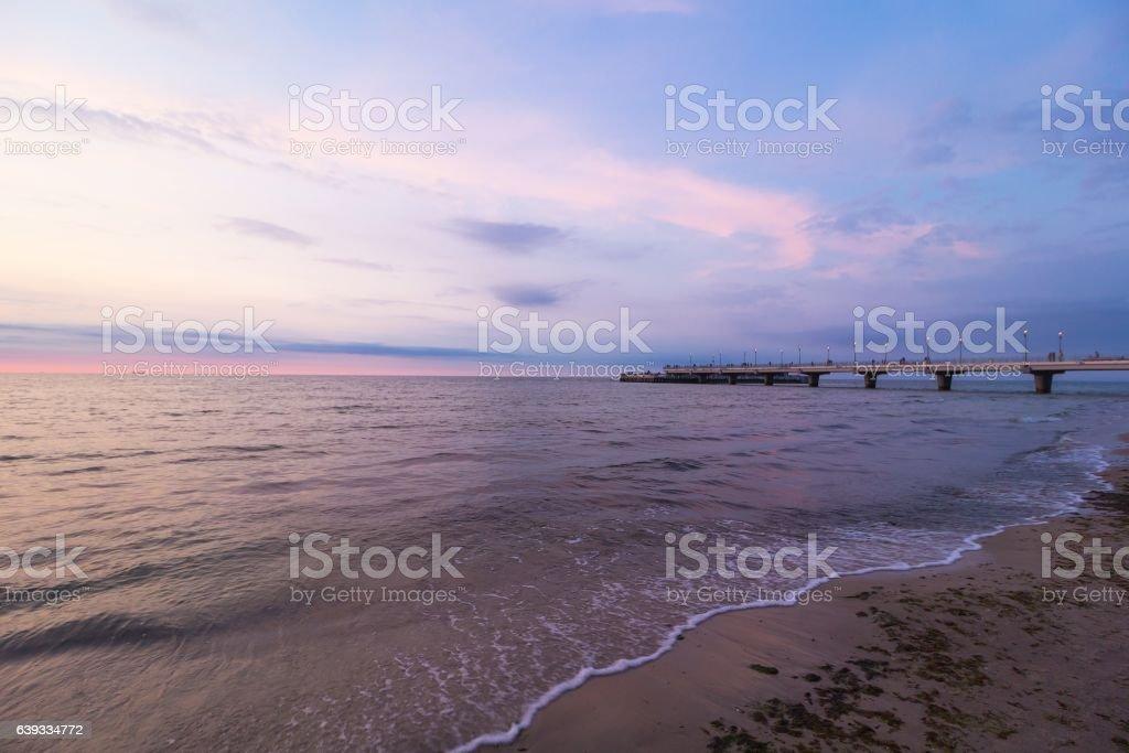 Kolobrzeg, Poland pier. Sea sunset shore landscape – zdjęcie