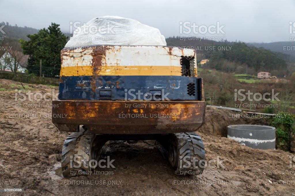 Viana do Castelo, Portugal - February 15, 2018: Komatusu excavator at construction site. Komatsu is a Japanese multinational corporation manufacturing heavy industrial and military equipment. stock photo