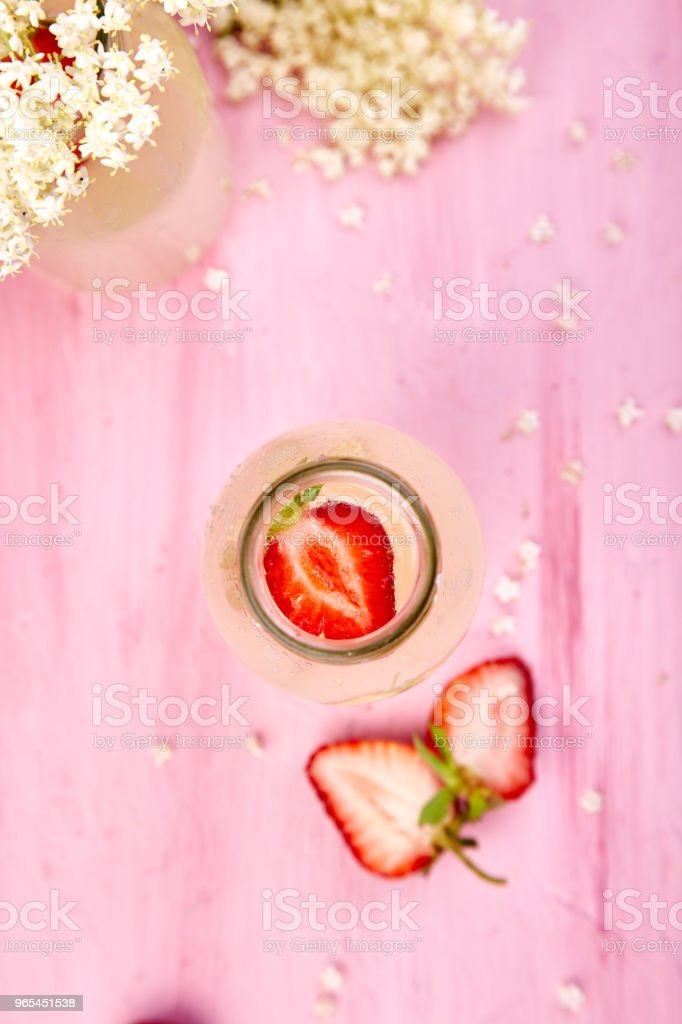 Kombucha tea with elderflower flower and strawberry royalty-free stock photo
