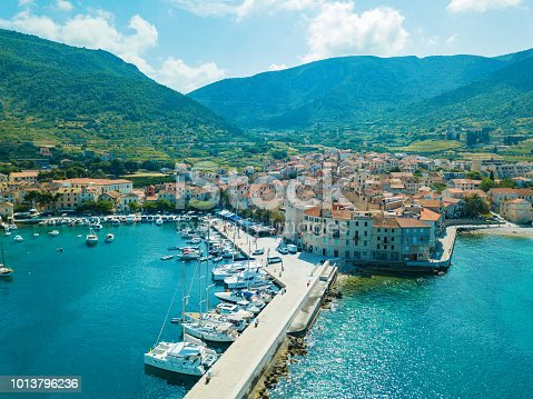 Komiža town on island Vis, Dalmatia, Croatia, where parts of Mamma Mia 2 movie were filmed. Photo made with drone DJI Mavic Pro from above.