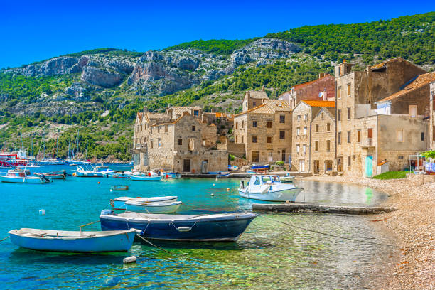 Komiza seascape island Vis. Seafront scenic view at Komiza summer scenery in South of Croatia, mediterranean travel places. croatian culture stock pictures, royalty-free photos & images