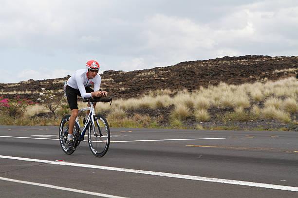 Kona Ironman Triathalon Kona, Hawaii, USA - October 11, 2014: Kona Ironman athlete #1215, Søren Jørgensen (DNK), during the return bike portion of the annual Kona Ironman triathalon. neicebird stock pictures, royalty-free photos & images