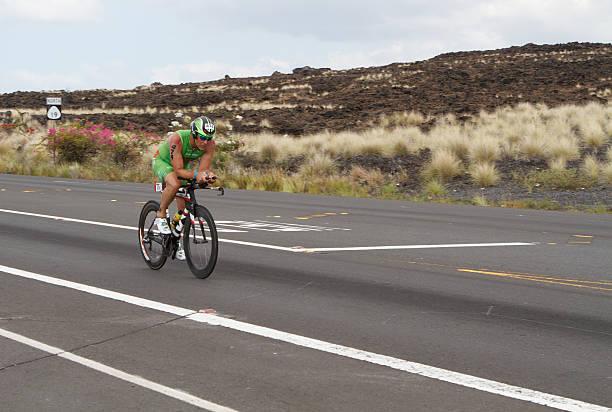 Kona Ironman Triathalon Kona, Hawaii, USA - October 11, 2014: Kona Ironman athlete #474, Uwe Weigert (DEU), during the return bike portion of the annual Kona Ironman triathalon. neicebird stock pictures, royalty-free photos & images