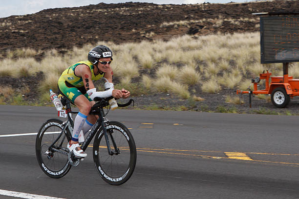 Kona Ironman Triathalon Kona, Hawaii, USA - October 11,  2014: Kona Ironman athlete #942, Jamie Rankin  (AUS), during the return bike portion of the annual Kona Ironman triathalon. neicebird stock pictures, royalty-free photos & images