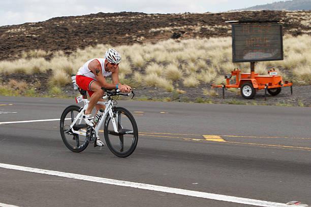 Kona Ironman Triathalon Kona, Hawaii, USA - October, 11th 2014: Kona Ironman athlete #665, Gerald Roth (AUT), during the return bike portion of the annual Kona Ironman triathalon. neicebird stock pictures, royalty-free photos & images