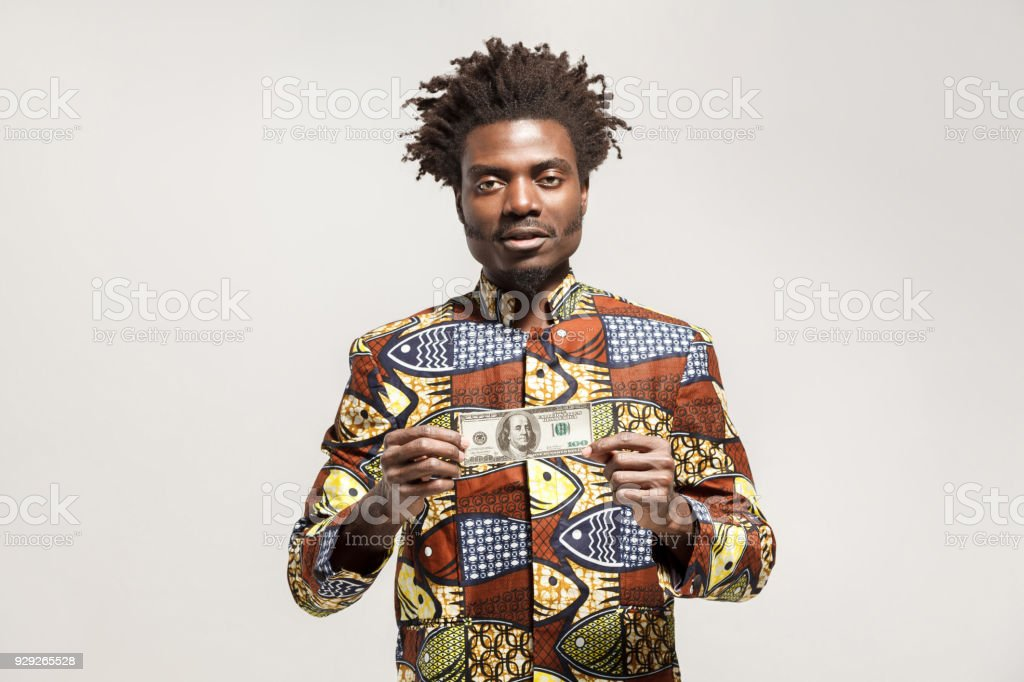 Kongo businessman holding one dollar and looking at camera stock photo
