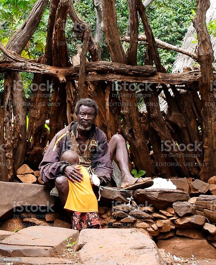 Konso aka Xonsita tribe man with baby - 03 october 2012 , Omo valley, Ethiopia stock photo