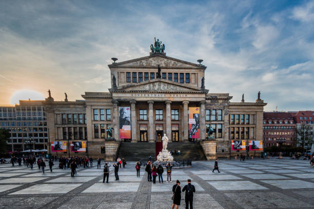 Konzerthaus Berlin Konzerthhaus Berlin at sunset with a busy square filled with people. gendarmenmarkt stock pictures, royalty-free photos & images