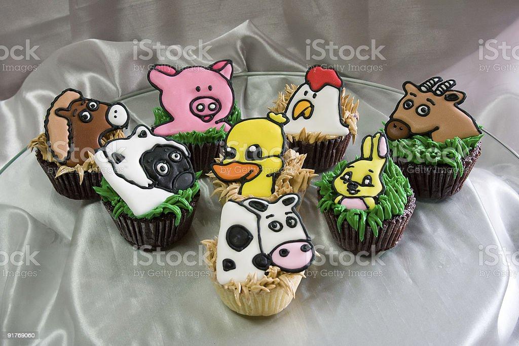 Kooky barnyard animal cupcakes royalty-free stock photo
