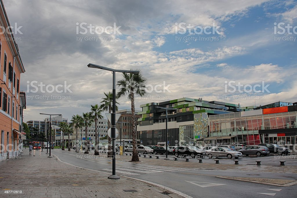 Koper city street with parking and shopping center stock photo