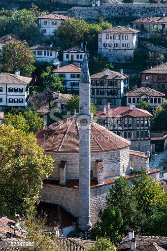 Koprulu Mehmet Mosque built 358 years ago with traditional Safranbolu houses background in Safranbolu, Turkey. Ottoman architecture.