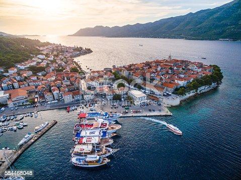 Aerial view on Korcula town with marina and anoored sailboats and yachts. Shot from a drone Phantom 3. Island Korcula, Dalmatia, Croatia.