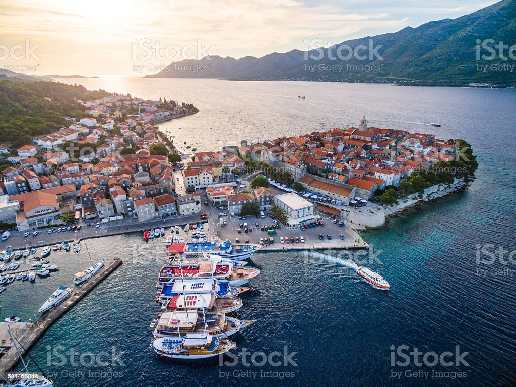 Korcula town and marina with sailboats from above stock photo