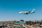 Los Angeles, United States - October 19th, 2018: Korean Air A380 landing at LAX (Tom Bradley International Airport) in Los Angeles at mid day over traffic city streets.