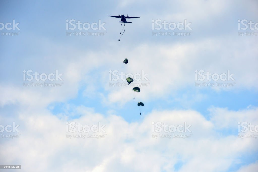 Korean airborne troops falling out of a military transport plane stock photo