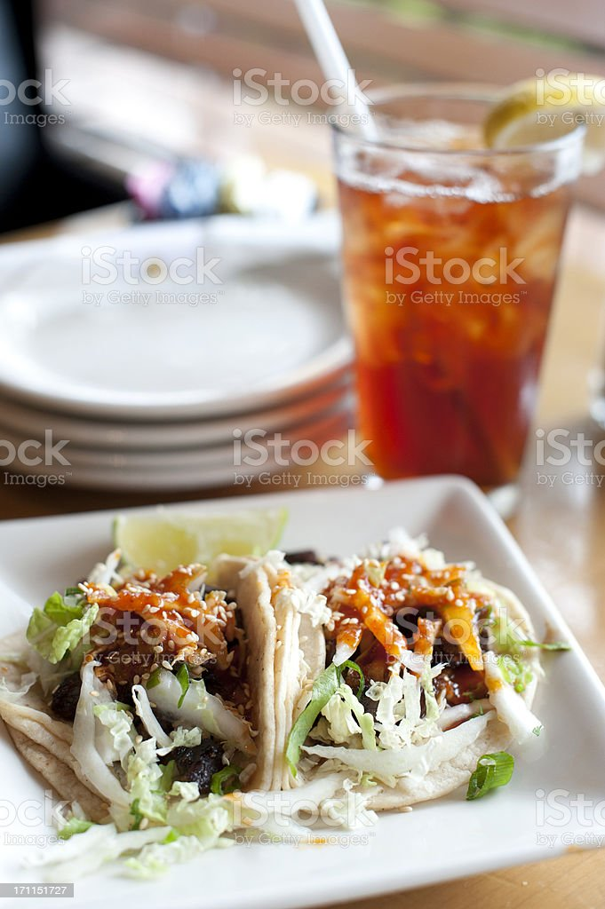 Korean Beef Tacos with lemon tea stock photo